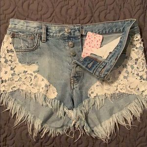 Free people distressed denim and lace shorts